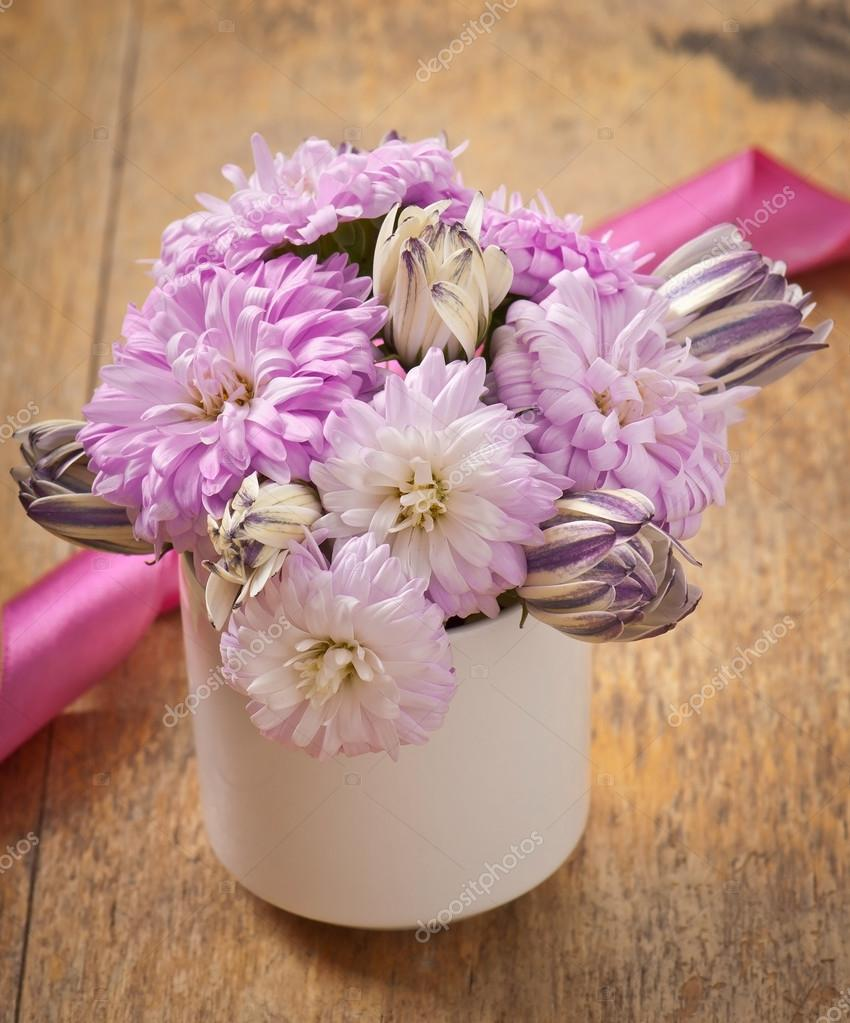 Beautiful Aster Flower Bouquet On Wooden Table Stock Photo