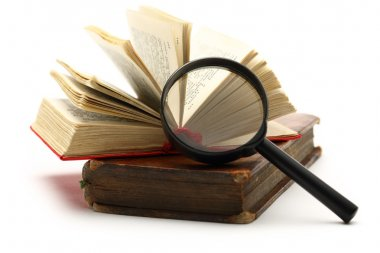 Magnifying glass and old books