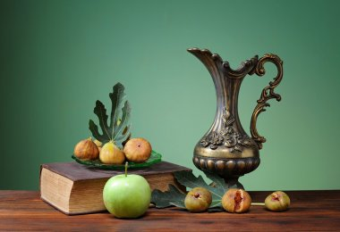 Metal bowl and green apple