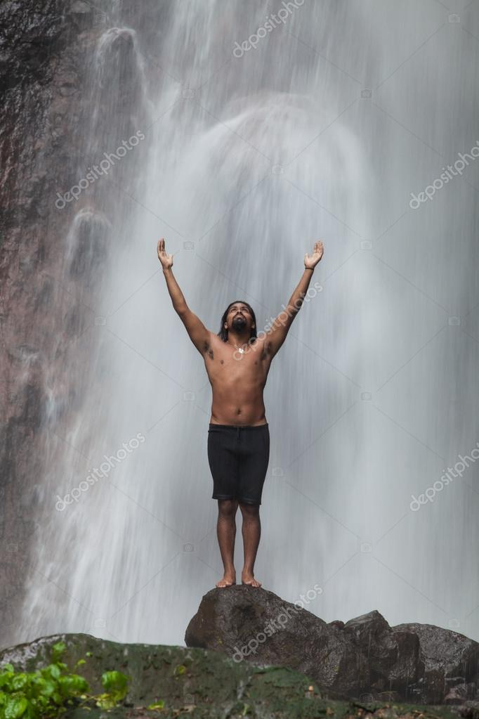 Man at waterfall