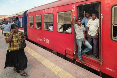 Local people in train at station in Sri Lanka