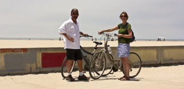 A Couple with Bikes on Mission Beach