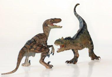 A Battle Between a Carnotaurus and a Velociraptor