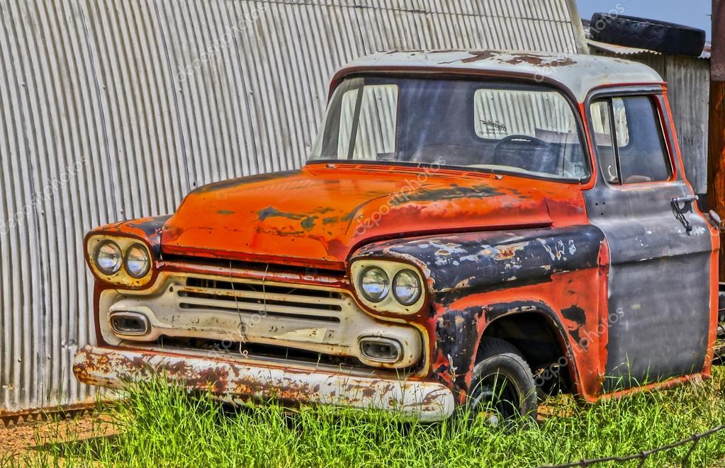 An Old Chevy Pickup Truck in a Junkyard – Stock Editorial Photo ...