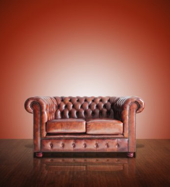 Classic Brown leather sofa and old background.