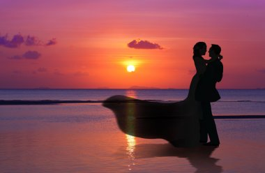 Married Couple on sunset beach