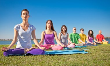 Group of young have meditation on yoga class.
