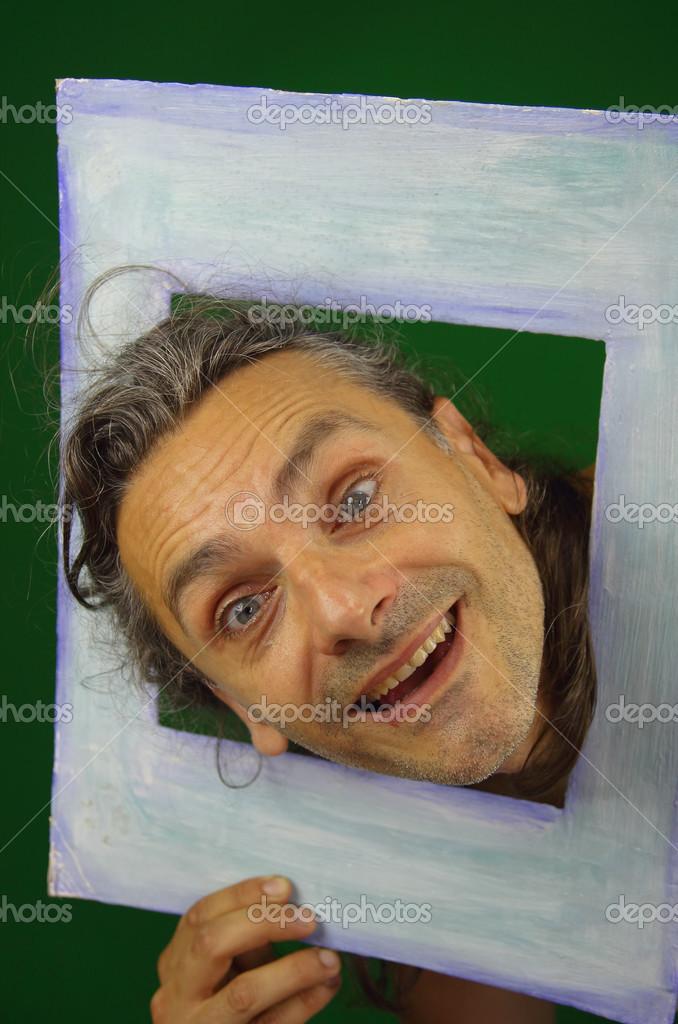 lustiger Mann in einen Bilderrahmen — Stockfoto © marcovarro #12455187