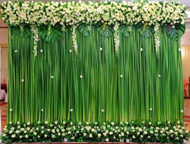 Green backdrop flowers arrangement