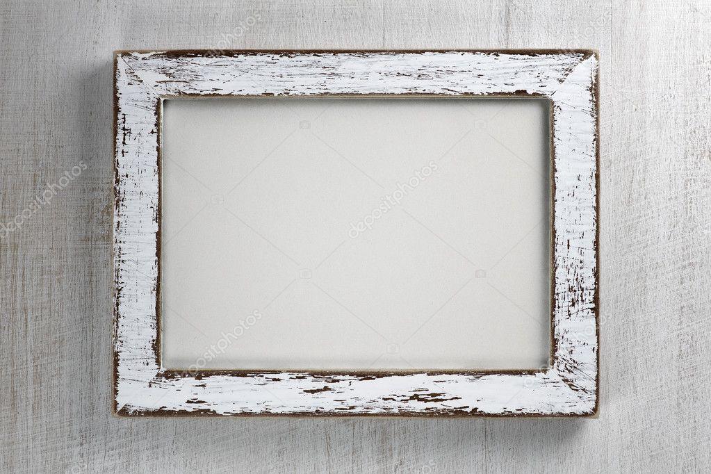 Vintage wooden frame on wall background