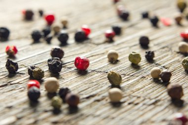 Peppercorn mix on vintage worn wooden table