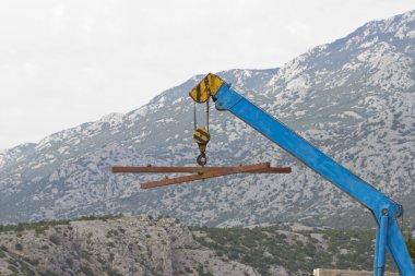 blue hoisting crane
