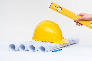 Architectural projects with yellow construction helmet