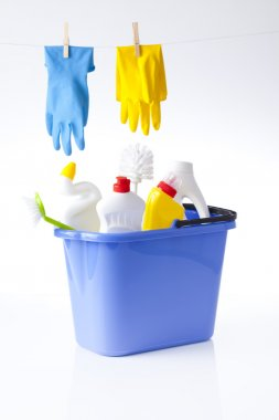 Cleaning detergents in bucket and gloves