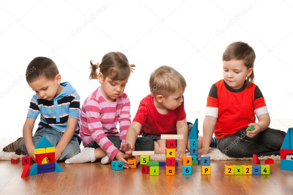 Four children are playing on the floor