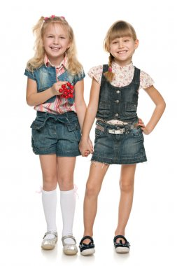 Little cheerful girls with red berries
