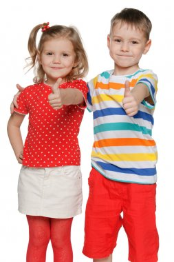 Two cheerful children hold his thumbs up