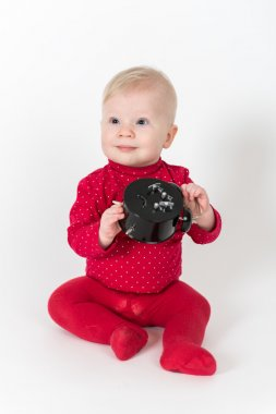 Sitting baby with clock in red suite