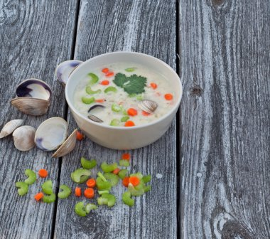 Clam chowder soup on old wood background