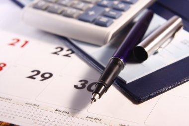 Pen, Calculator, Calendar and Cheque Book