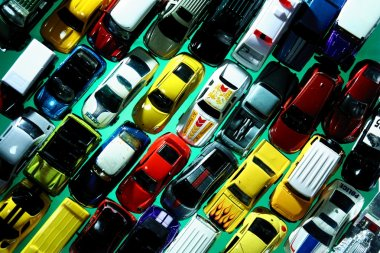 Different types and colors of toy cars