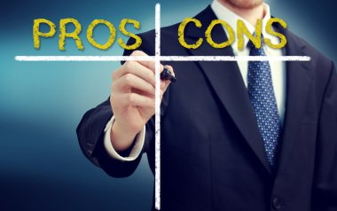 Business man writing pros and cons