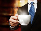 Fotografie Business Man Holding a Cup of Coffee