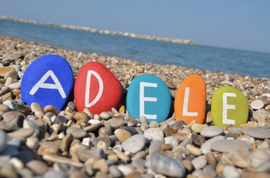 Adele, female name on colourful stones