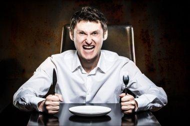 Mad man waiting his food