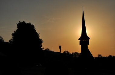Silhouette of a church tower in the sunset