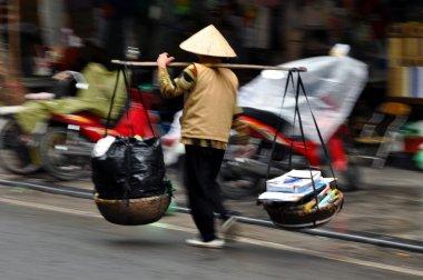 Street vendors in Hanoi selling their goods. Hanoi, Vietnam