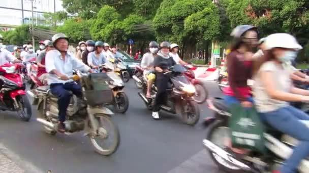 Chaoticky silničního provozu, tisíce motocyklů v Saigonu (Ho Či Minovo město), Vietnam