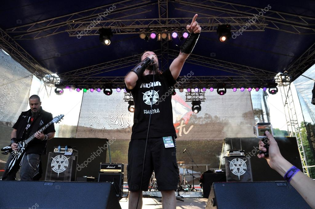 Altar rock, heavy metal band performs live a concert on the