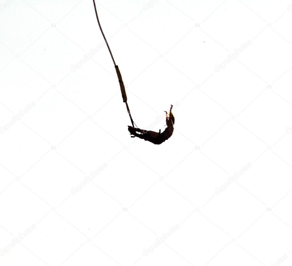 8299aa170f9a Silhouette of a bungee jumping woman isolated on white background ...