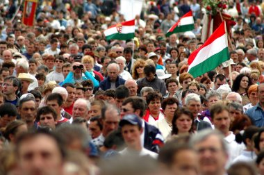 Crowds of Hungarian pilgrims at a religious celebration
