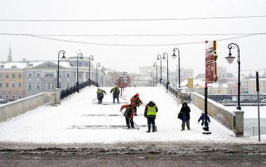 Workers clearing the bridge from snow. Snowstorm in Moscow