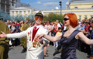 A war veteran dances with a woman