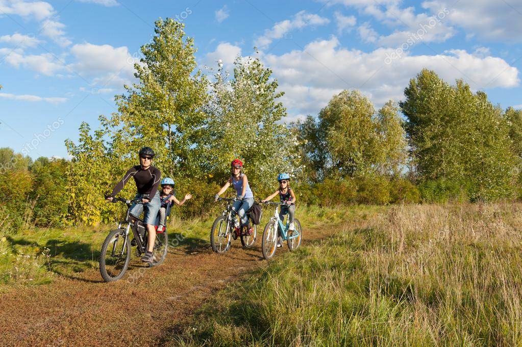 Active family on bikes cycling outdoors
