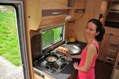 Woman cooking in camper