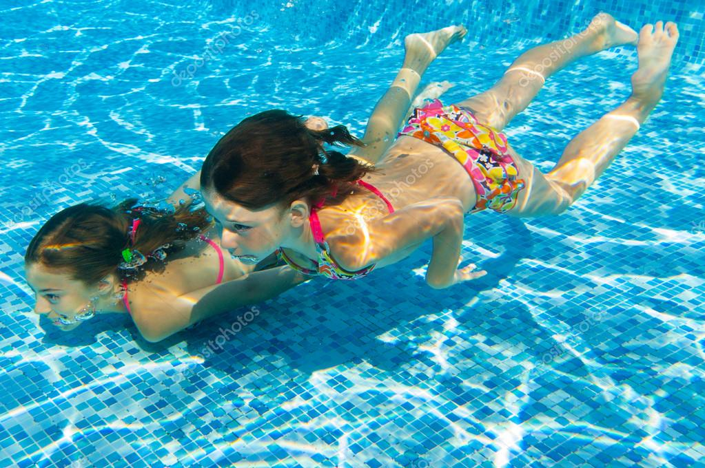 Kids Swimming Underwater kids swim underwater in pool — stock photo © jaysi #25929347