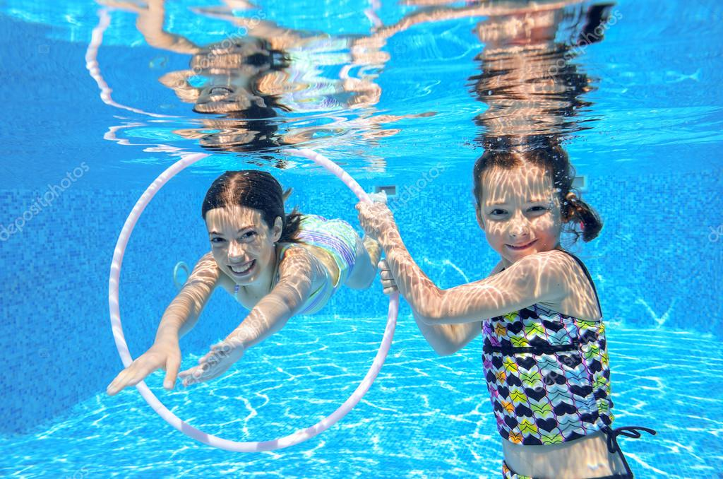 Happy Active Kids Play Underwater In Swimming Pool Stock Photo Jaysi 50136933
