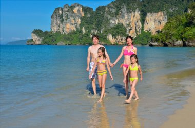Happy family on tropical beach