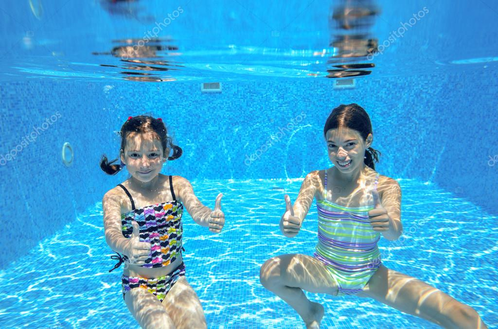Kids Swimming Underwater happy active kids swim in pool and play underwater — stock photo