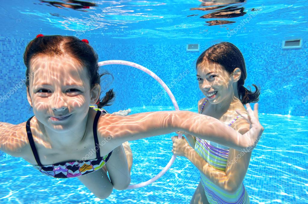 Happy Active Kids Swim In Pool And Play Underwater Stock Photo