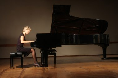 Grand piano pianist playing concert
