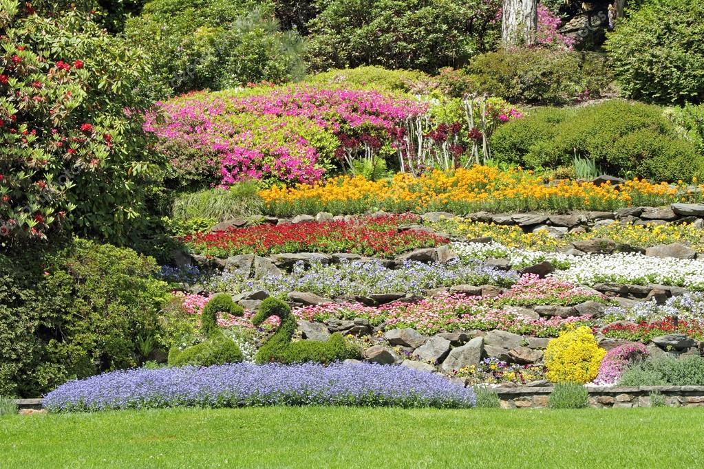 Multicolor flower beds on hillside