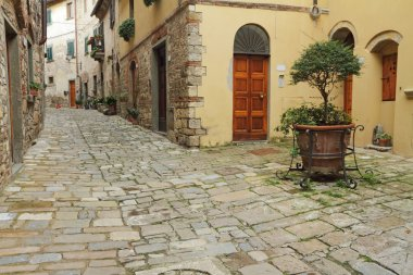 Narrow italian street and small patio