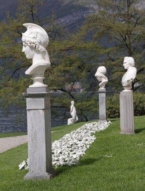 Marble classic statues in italian garden of Villa Melzi in Bell