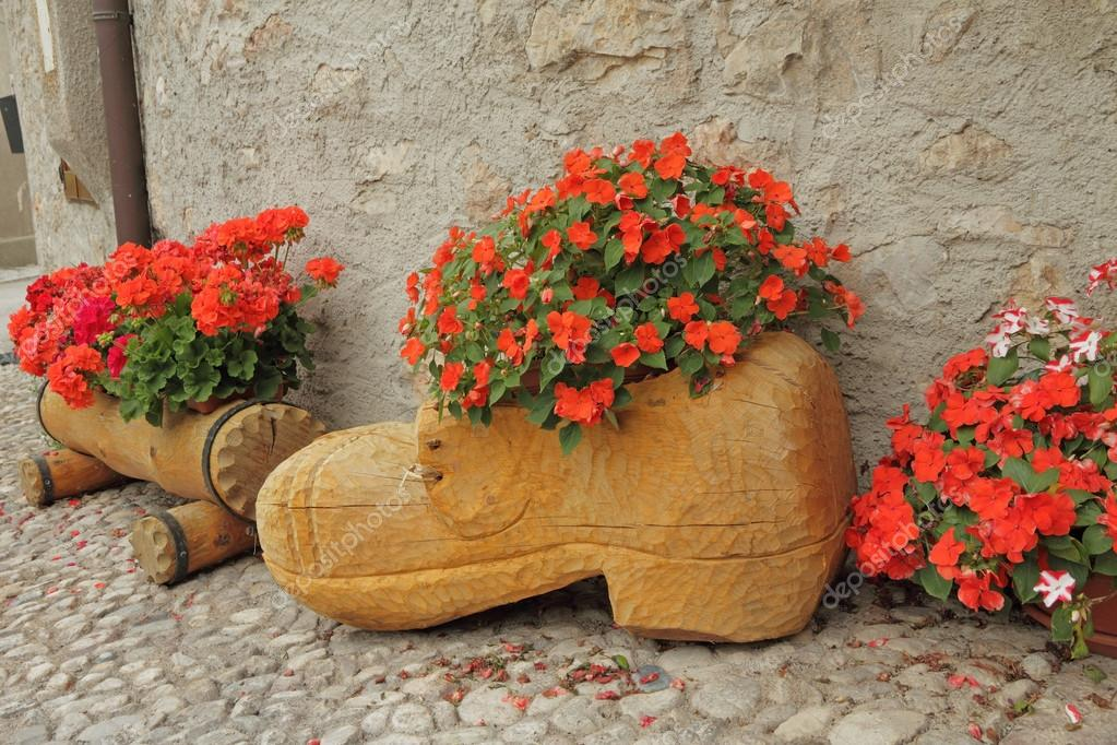 handmade wooden planters for flowering plants on country backyar