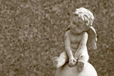 little cemetery angel statue and space for text